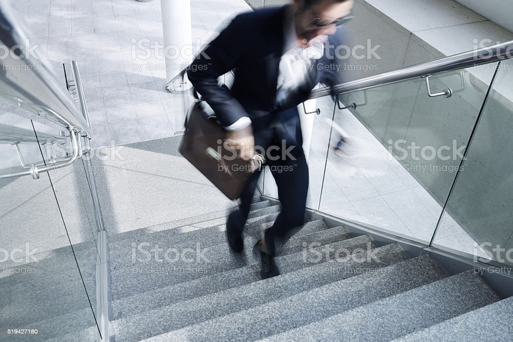 Businessman in hurry stock photo