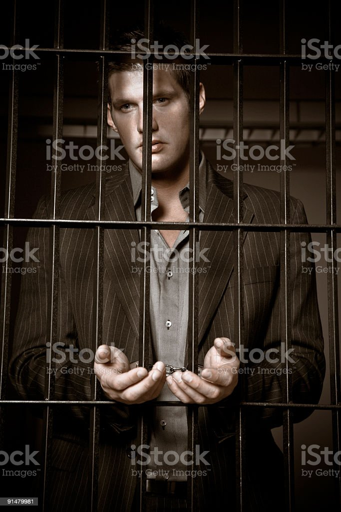 Businessman in jail royalty-free stock photo
