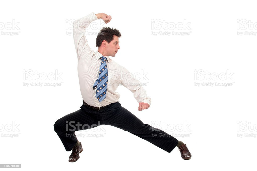 Businessman in kung fu pose stock photo
