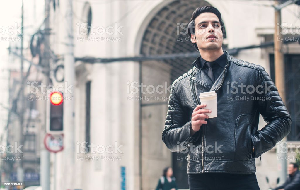 Businessman in leather jacket stock photo