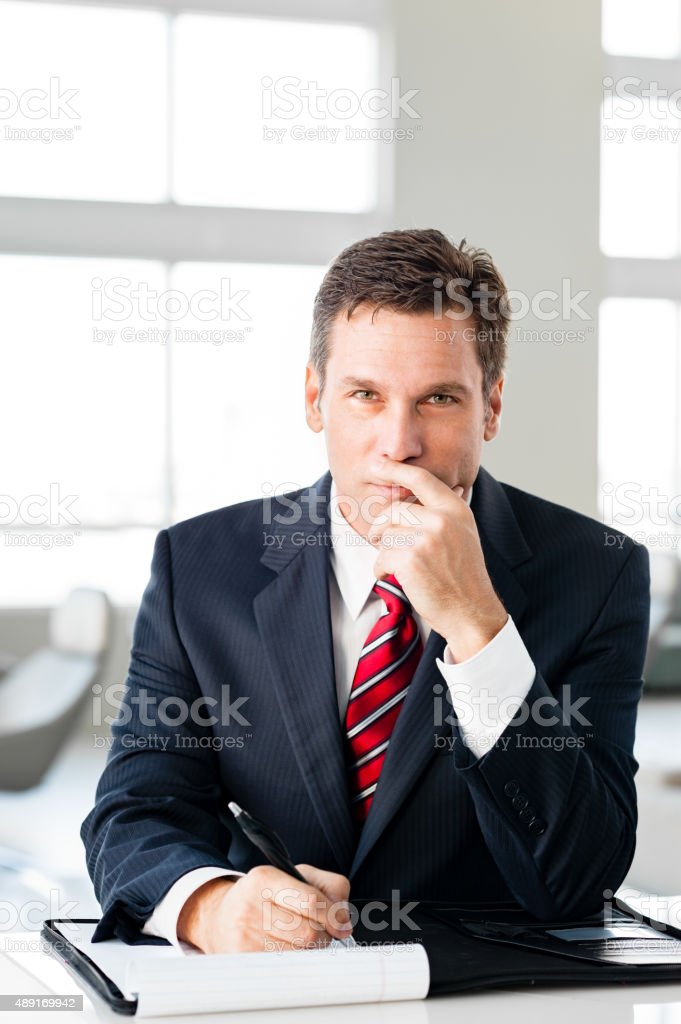 Businessman in lobby stock photo