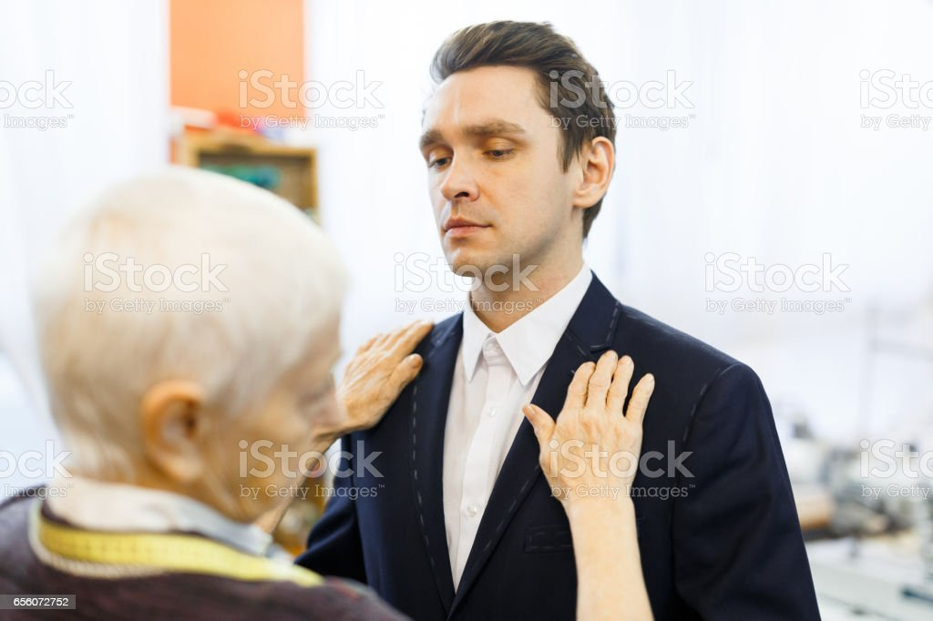 Businessman in new jacket stock photo
