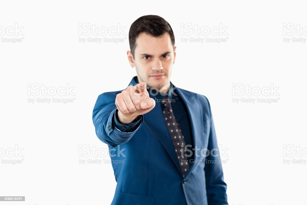 Businessman in office clothes pointing stock photo