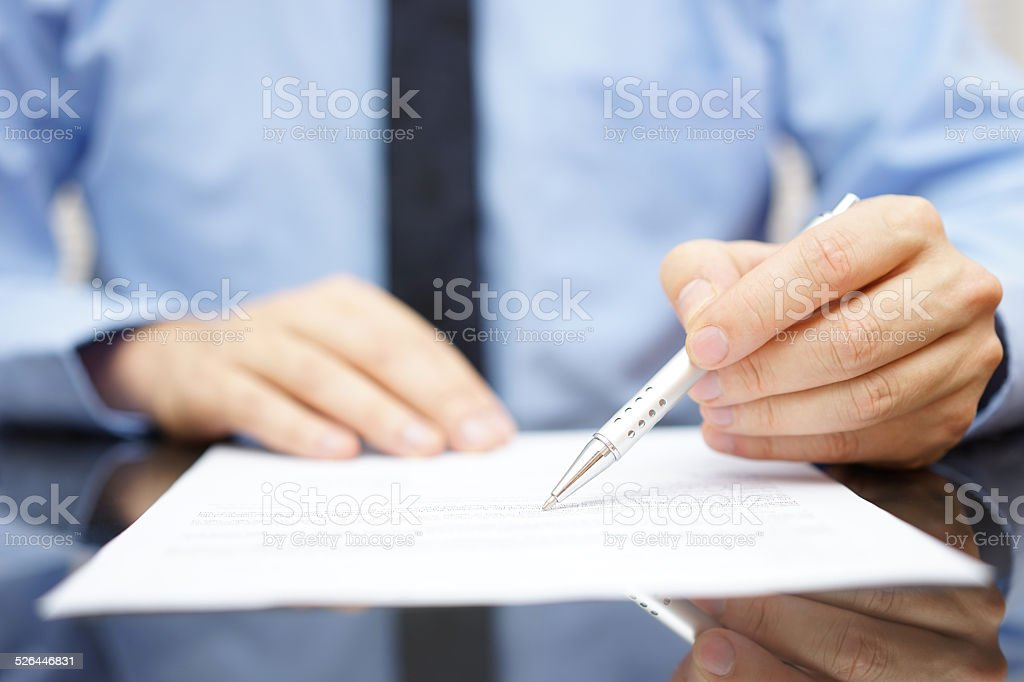 businessman in office is analyzing document stock photo