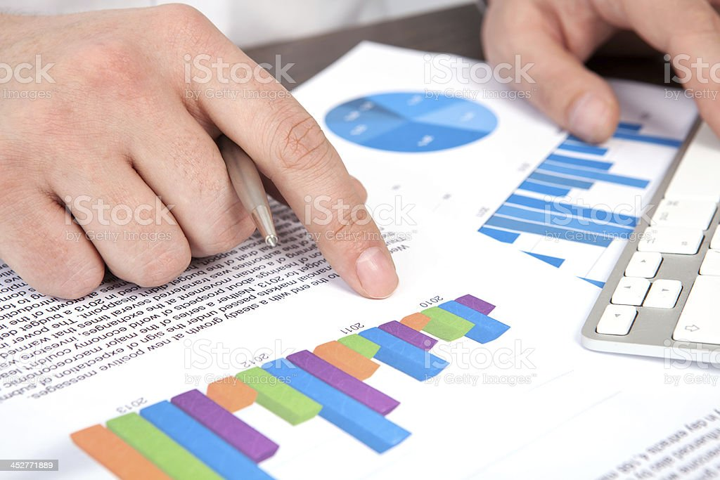 businessman in office of the table points to graphics royalty-free stock photo