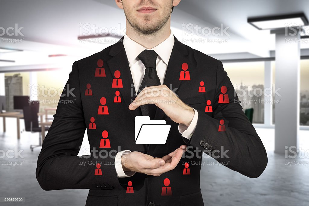 businessman in office protecting folder symbol cloud stock photo