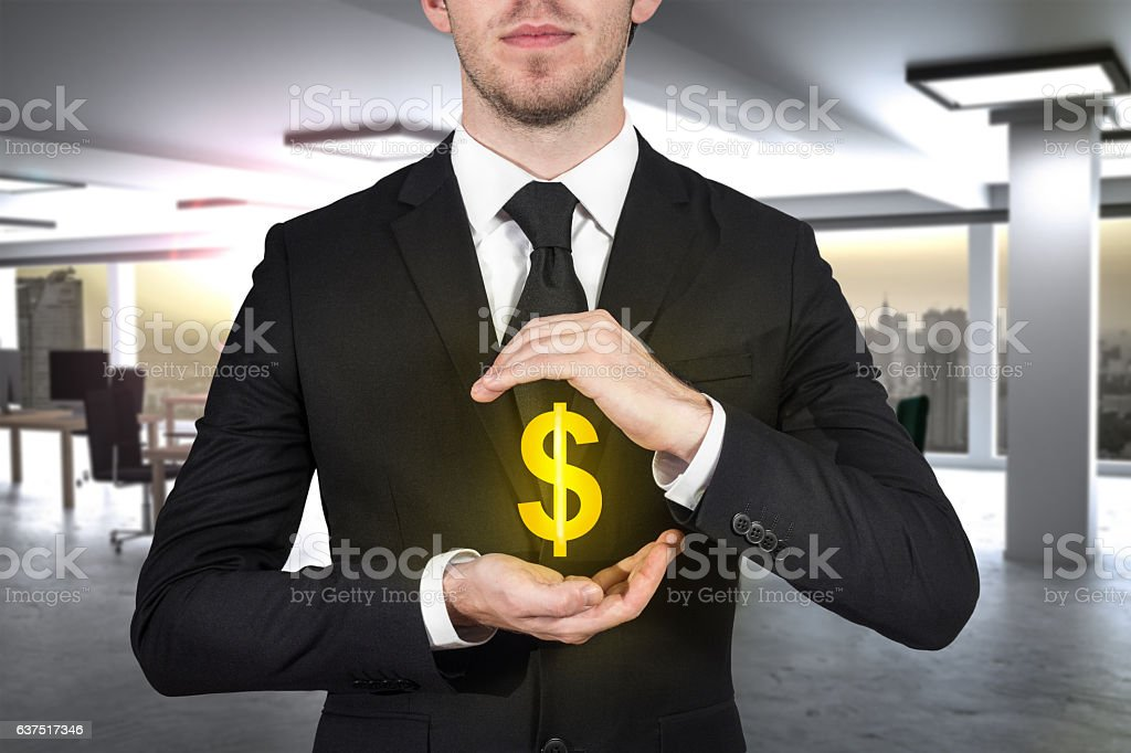 businessman in office protecting money dollar stock photo