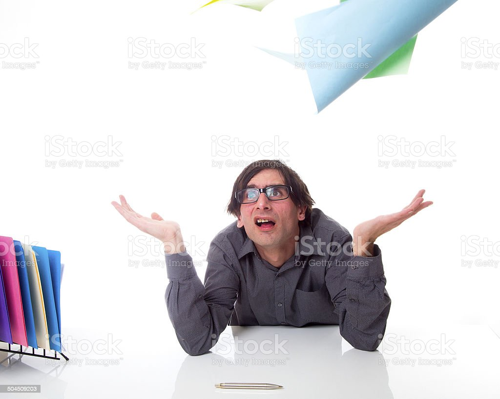 Businessman in office throwing and tearing paper in frustration royalty-free stock photo