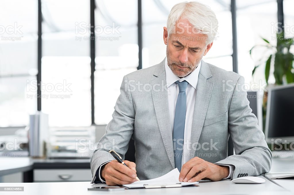 Businessman in office working stock photo