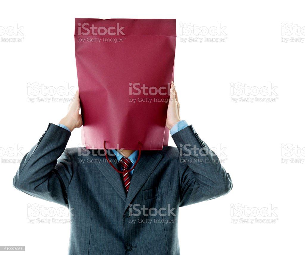 Businessman in paper bag mask against white background stock photo