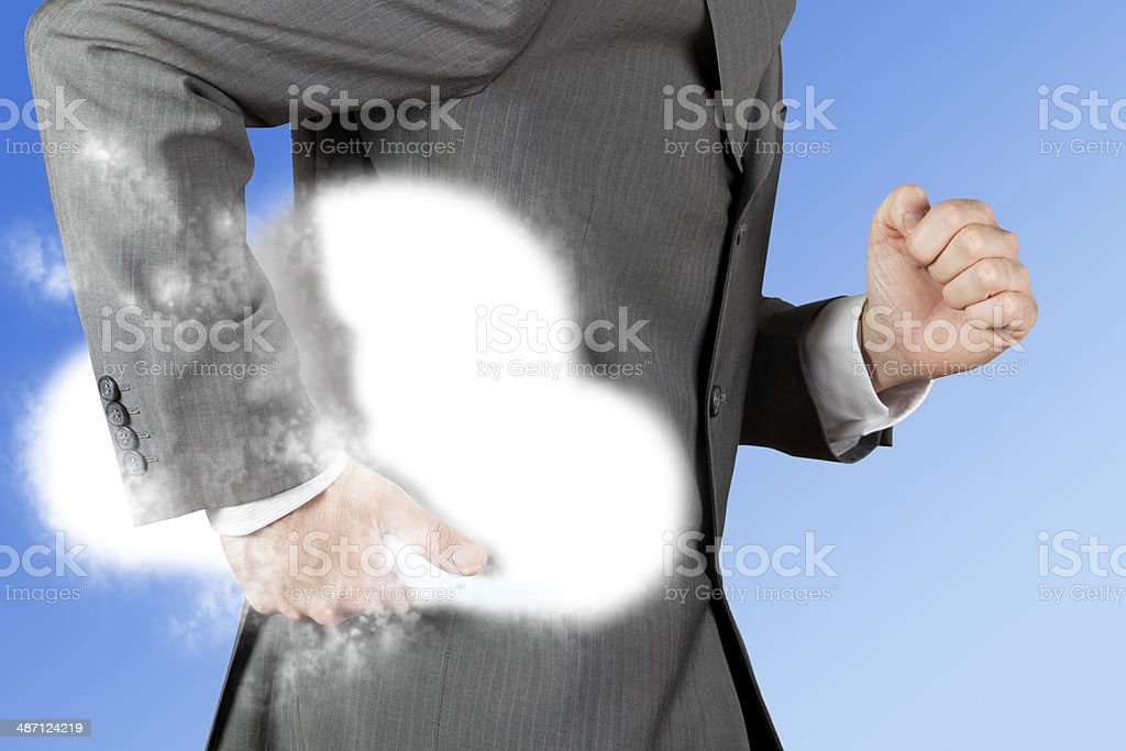 Businessman in pinstriped suit running and holding a cloud underarm stock photo