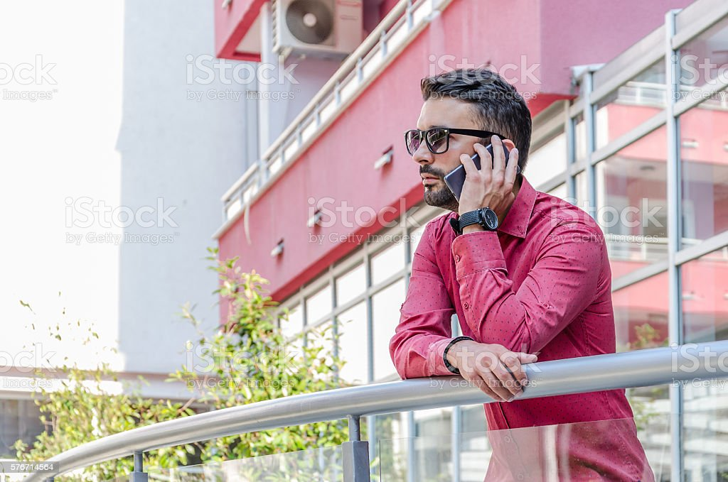 businessman in red shirt stock photo