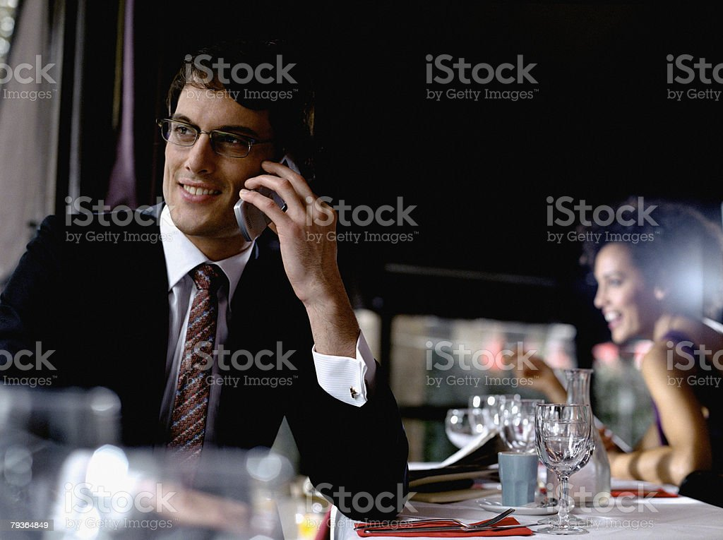 Businessman in restaurant on his mobile phone royalty-free stock photo