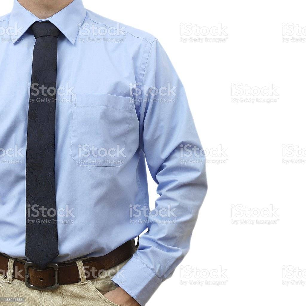 businessman in shirt with tie, jeans with hand in pocket stock photo