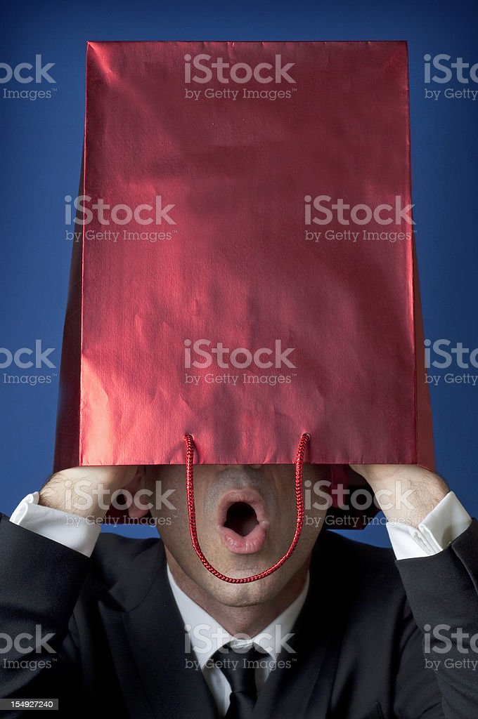 Businessman in Shopping Bag stock photo
