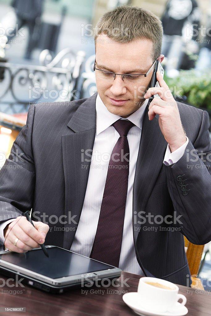 Businessman in sidewalk cafe royalty-free stock photo