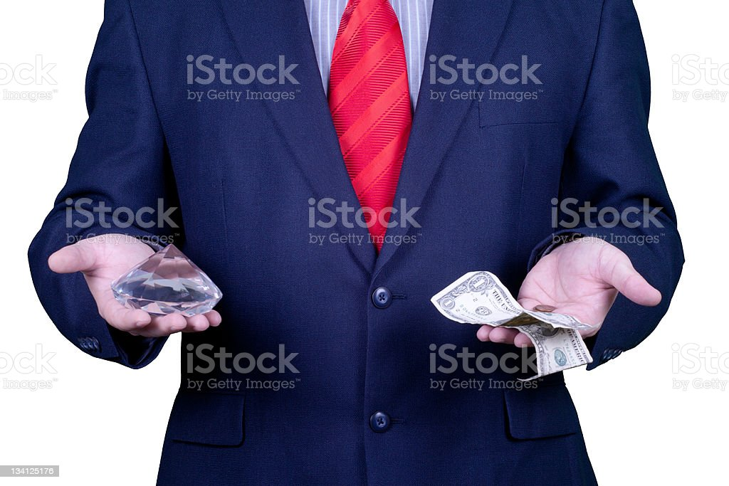 Businessman in suit and red tie holding a diamond royalty-free stock photo