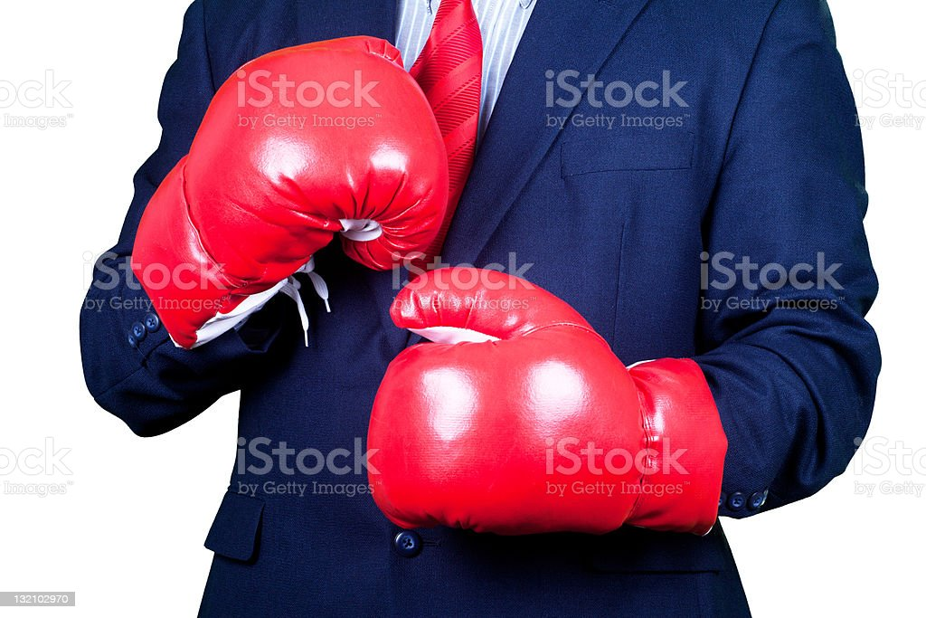 Businessman in suit and red tie ready for boxing royalty-free stock photo