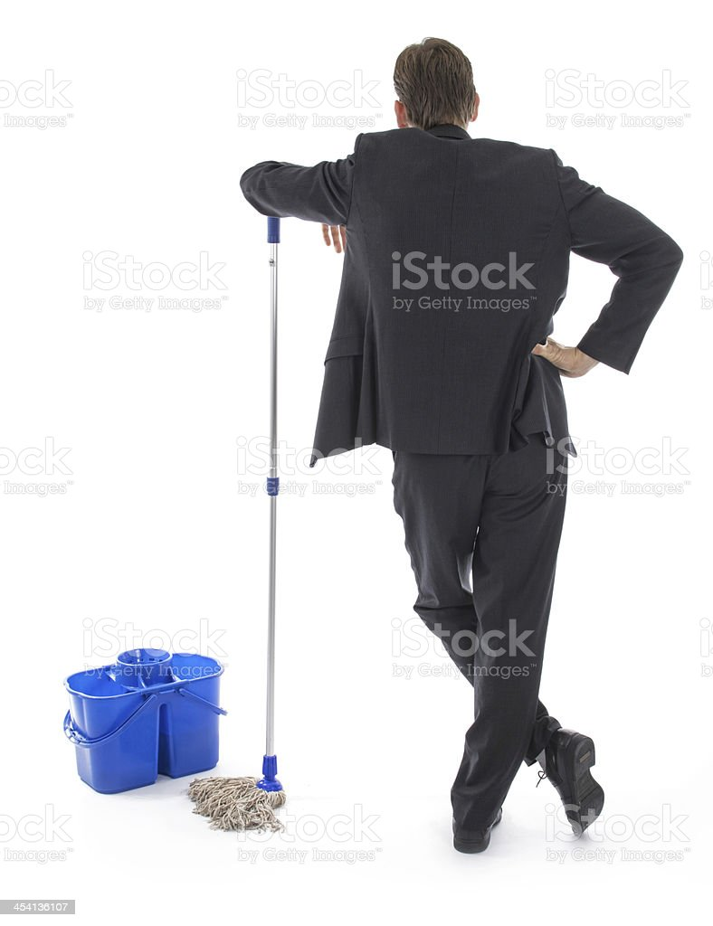 businessman in suit as cleaner. stock photo