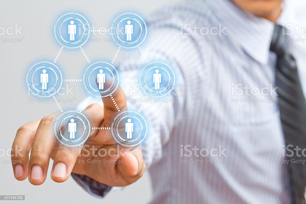 Businessman in suit finger presses virtual button stock photo