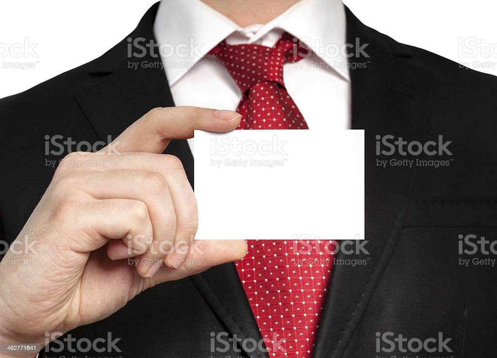 businessman in suit holding a white business card royalty-free stock photo