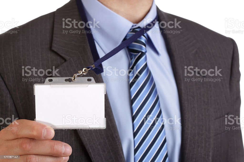Businessman in suit holding blank ID badge stock photo