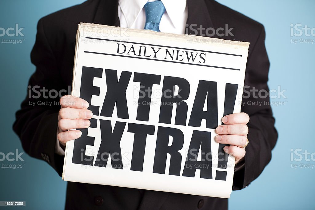 Businessman in Suit Holding Newspaper with Extra! Headline royalty-free stock photo