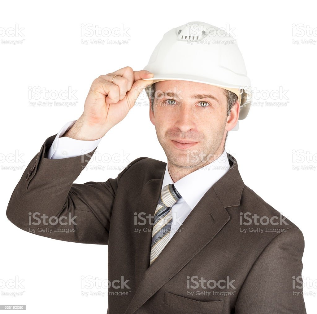 Businessman in suit raised his hard hat to greet stock photo