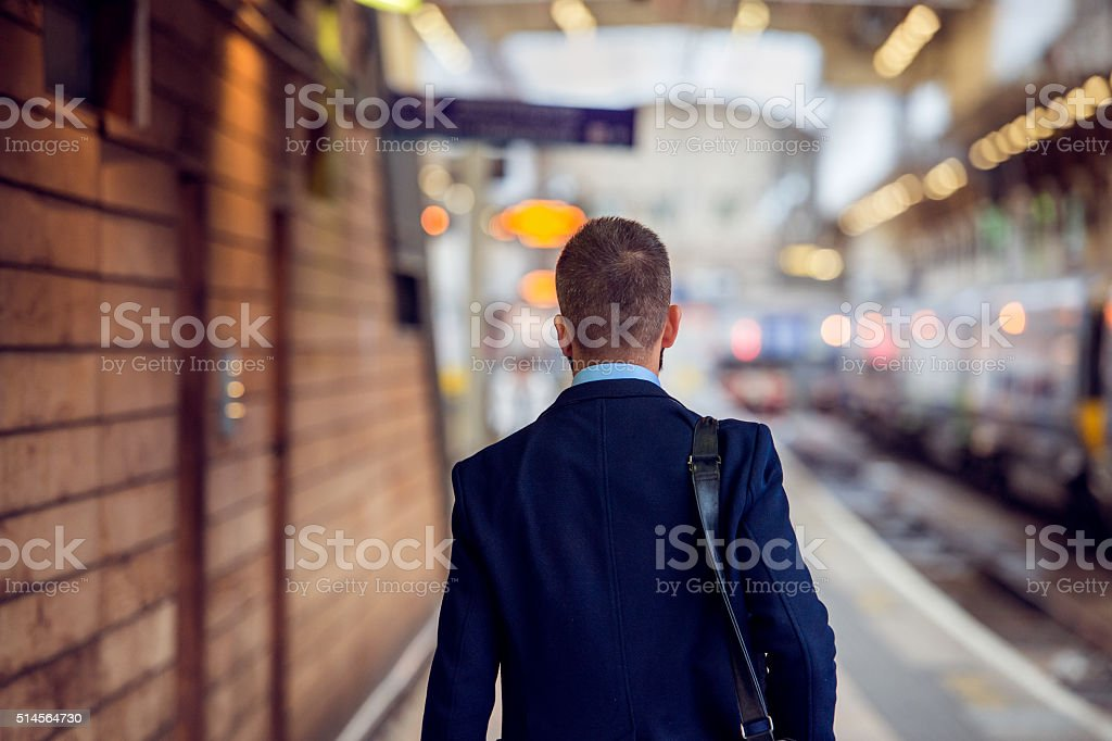 Businessman in suit walking at the staition, back view stock photo