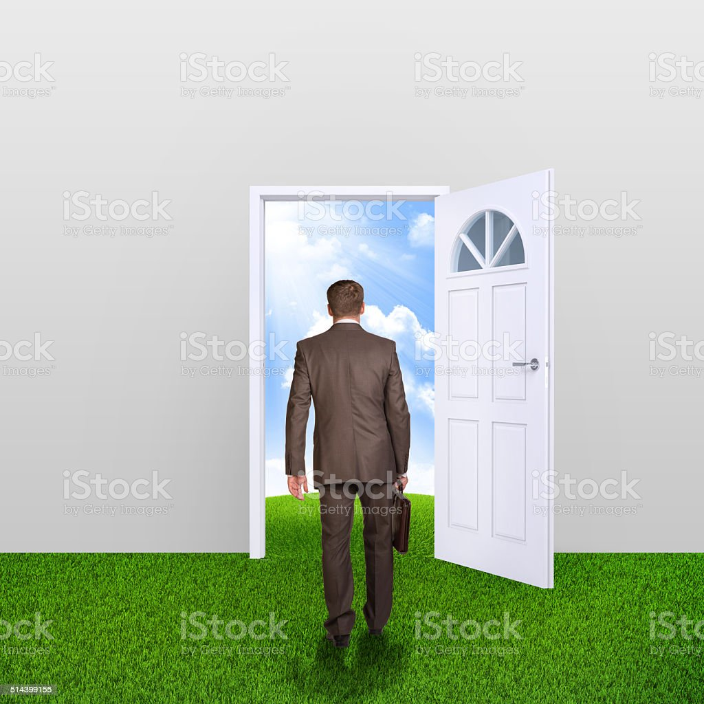 ... Businessman in suit with briefcase stepping through door stock photo ... & Stepping Into Door Pictures Images and Stock Photos - iStock Pezcame.Com