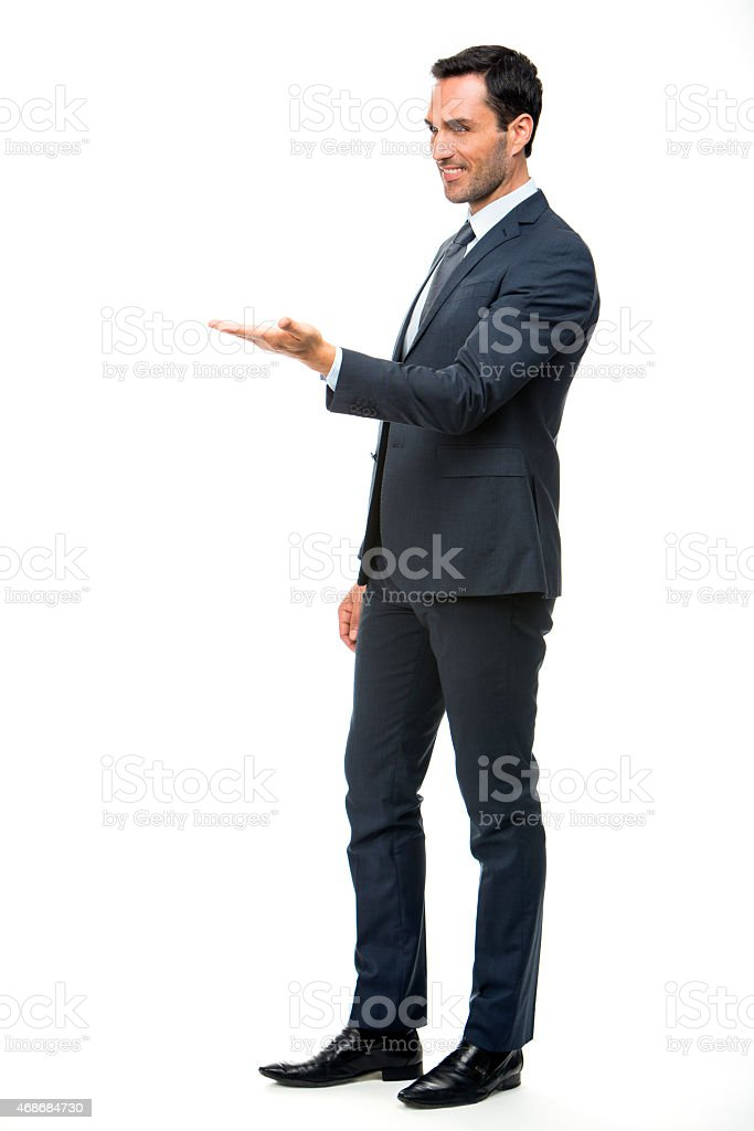 businessman in suit with lifted arm stock photo