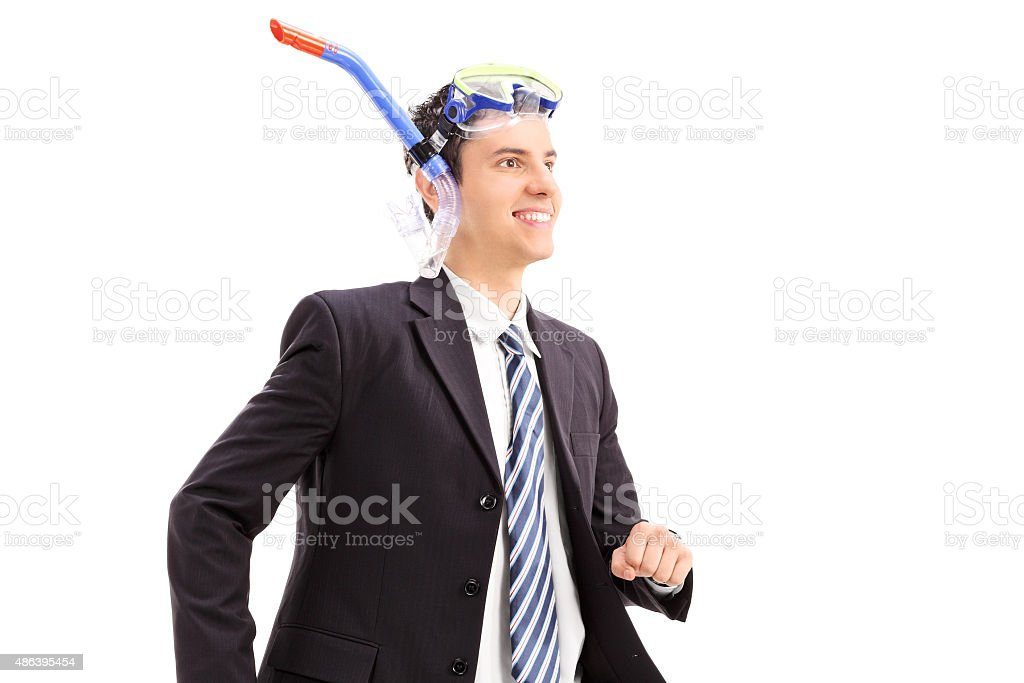 Businessman in suit with snorkering mask stock photo