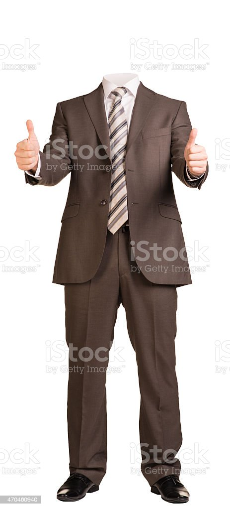 Businessman in suit without head, standing and showing thumbs-up stock photo