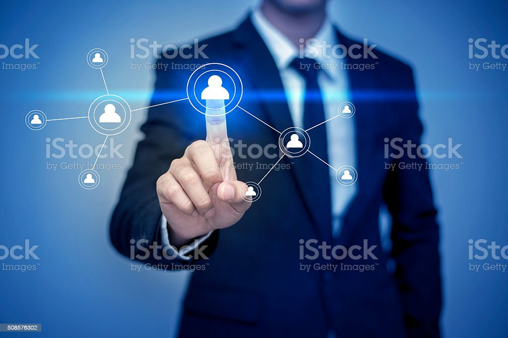 Businessman in suit working with digital virtual screen stock photo