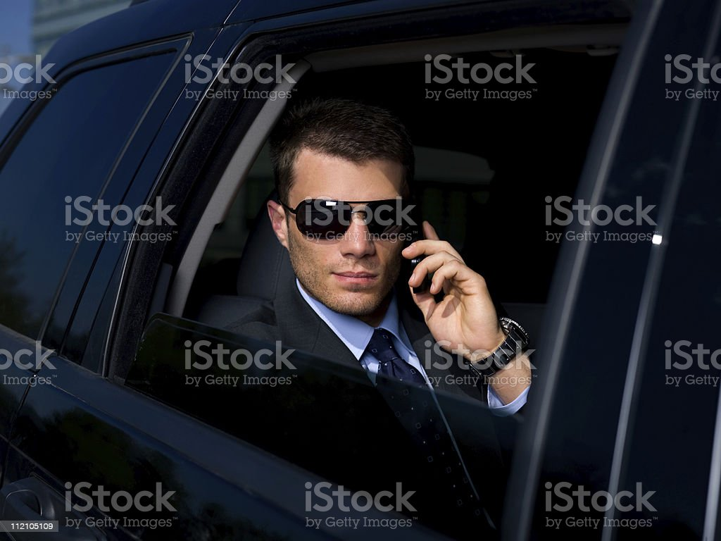 A businessman in the back of a car royalty-free stock photo