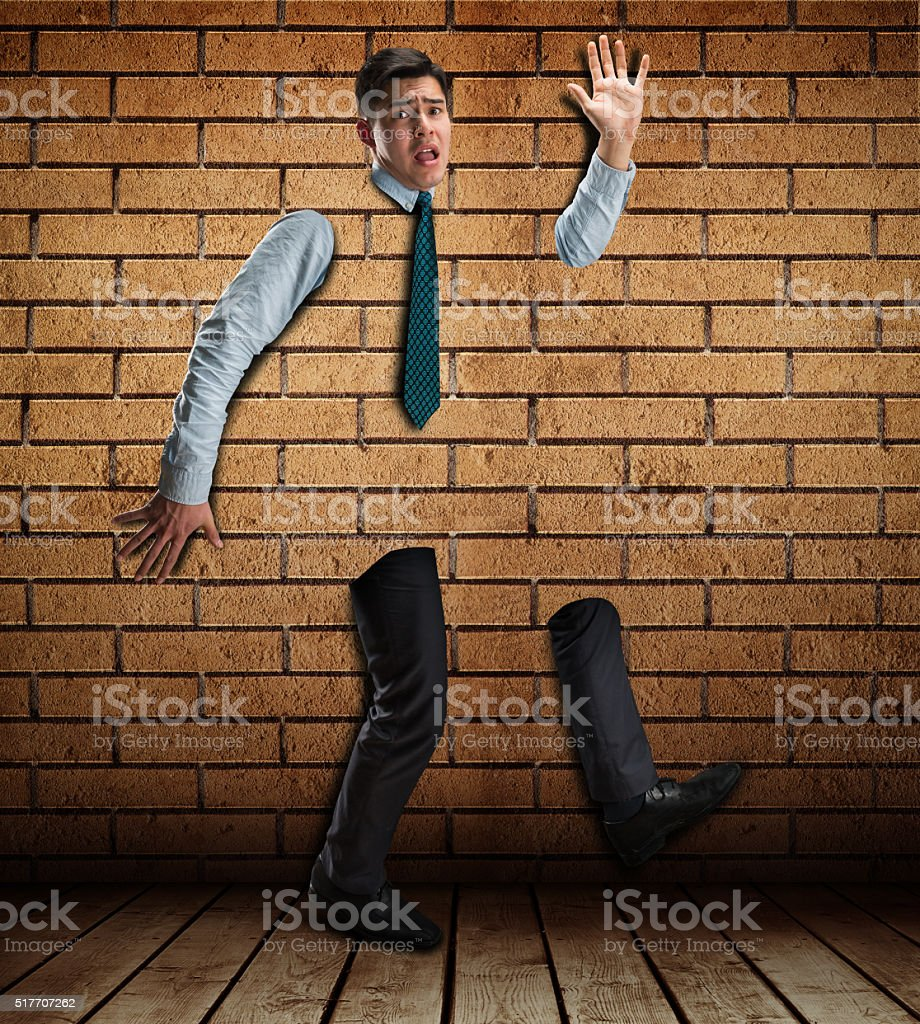 Businessman in the brick wall stock photo