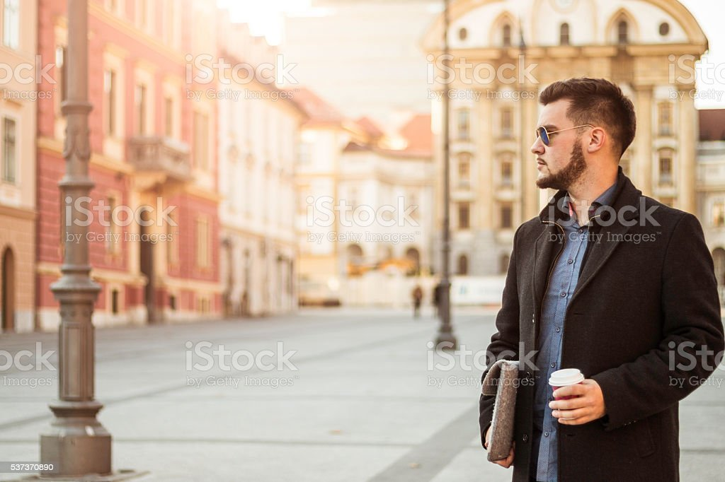 Businessman In The City With Coffee stock photo