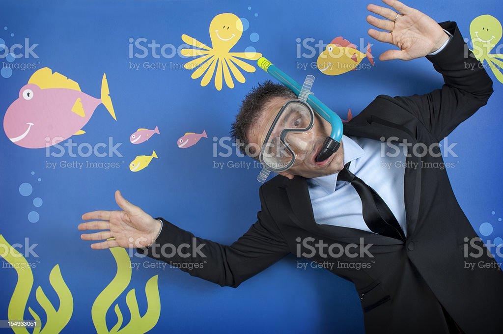 Businessman in the deep sea stock photo