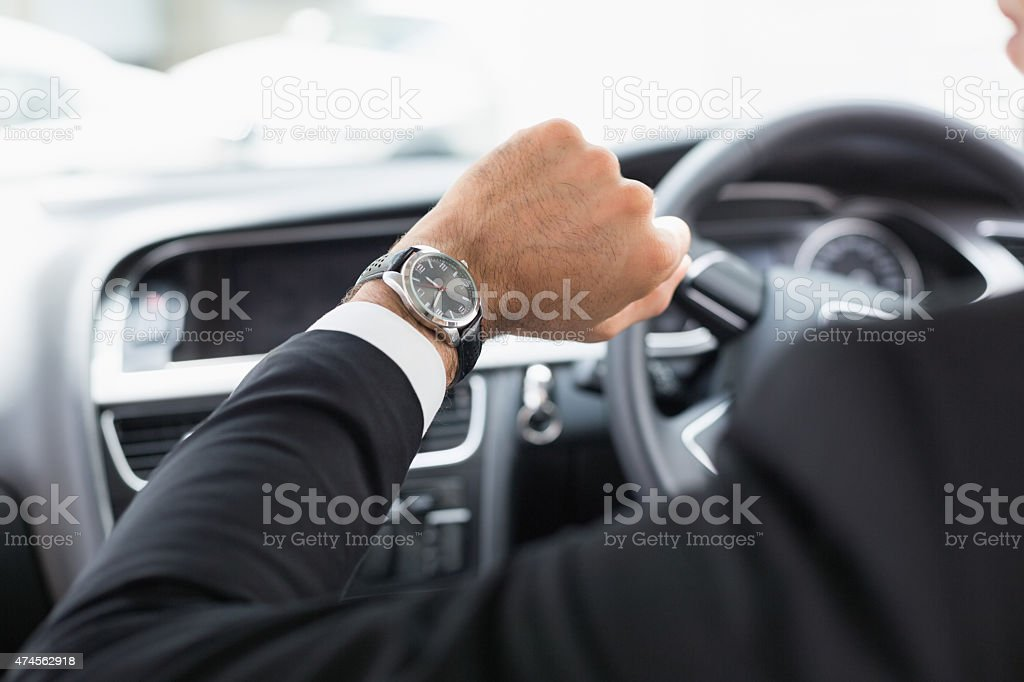 Businessman in the drivers seat stock photo