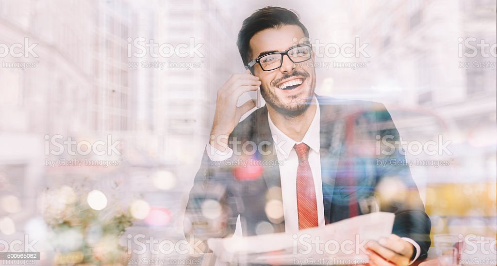 Businessman in the office having a phone call stock photo