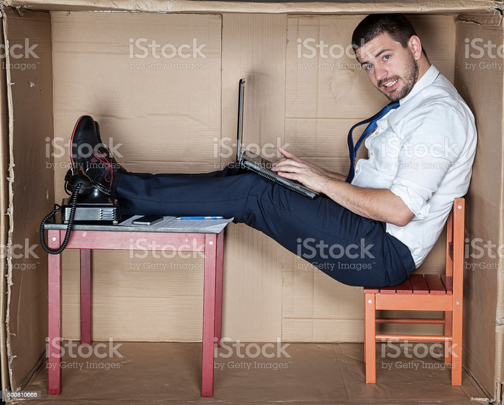 businessman in the office mad in box stock photo