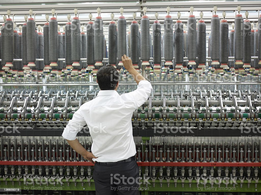 Businessman in the spinning factory royalty-free stock photo