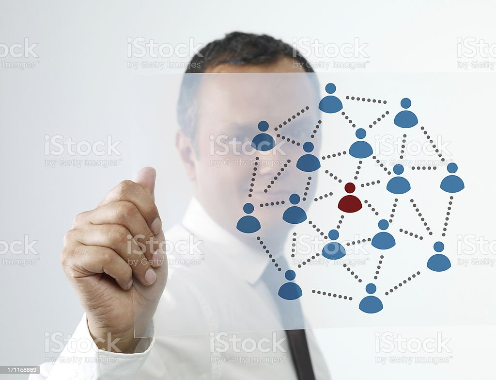 Businessman in tie showing connectivity diagram royalty-free stock photo