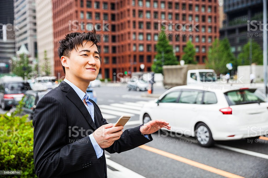 Businessman in Tokyo waiting for car pooling stock photo