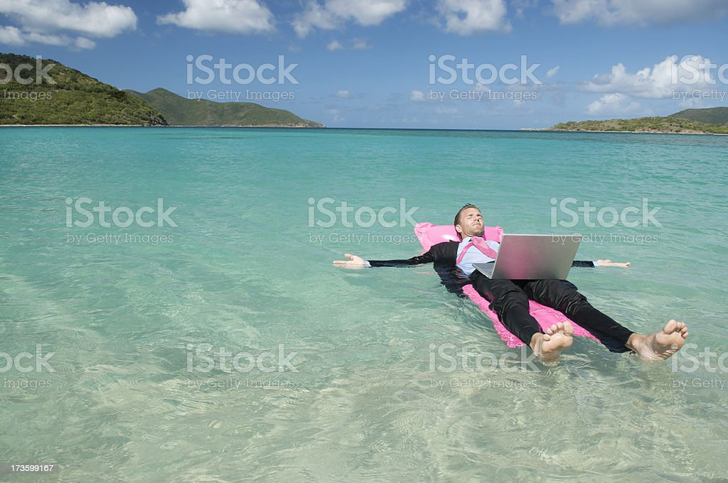 Businessman in Tropical Sea Floating on Water for Inspiration stock photo