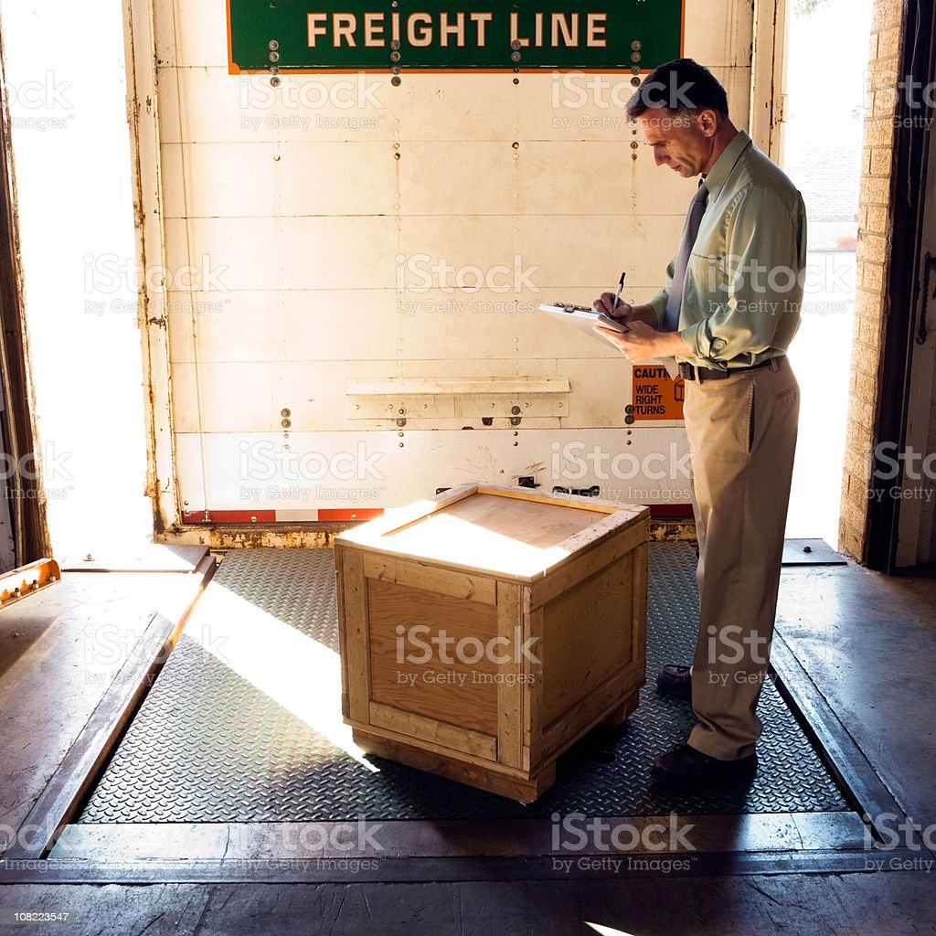 Businessman in Warehouse on loading dock. royalty-free stock photo