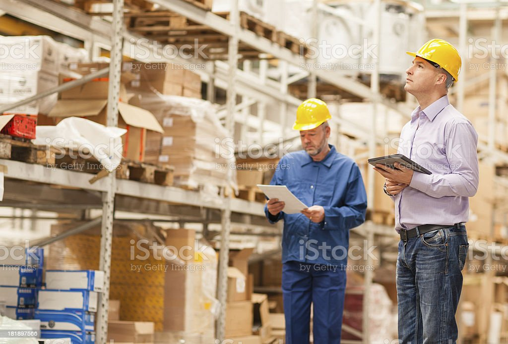 Businessman in warehouse royalty-free stock photo