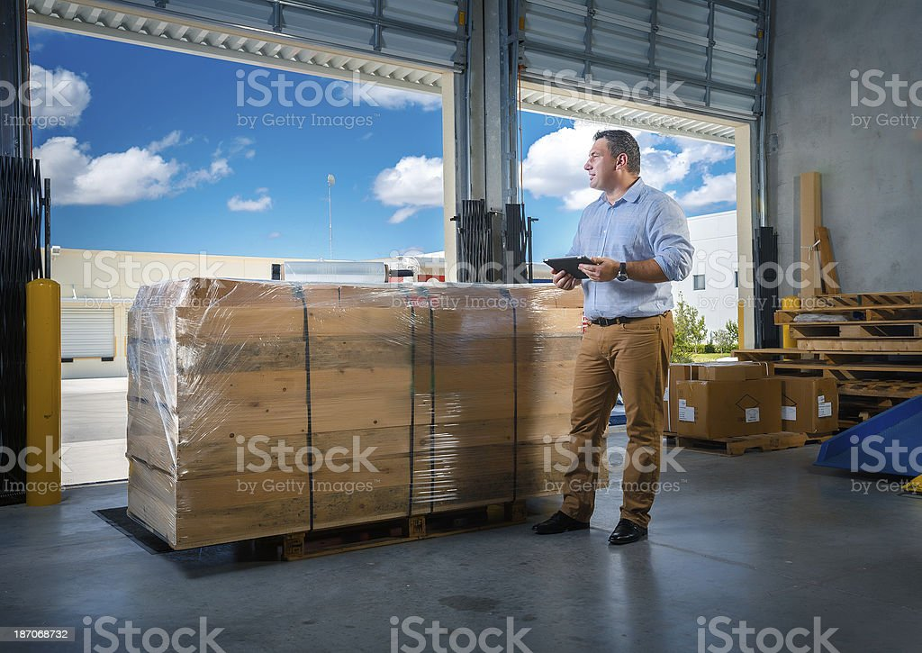 businessman in warehouse stock photo