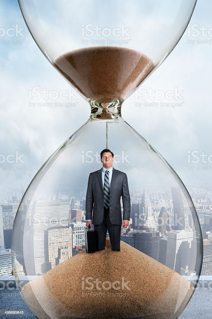 Businessman Inside An Hourglass stock photo