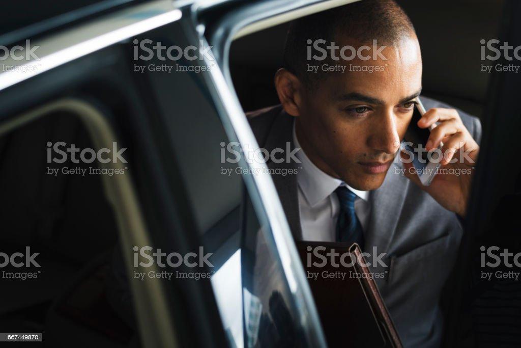 Businessman Inside Car Use Mobile stock photo
